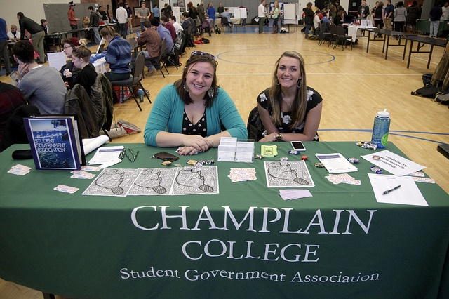 two students sitting at a student government booth