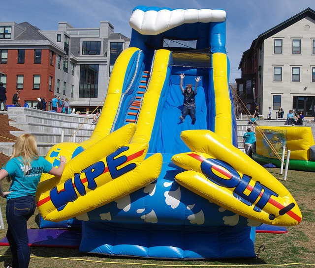 person sliding down giant inflatable slide