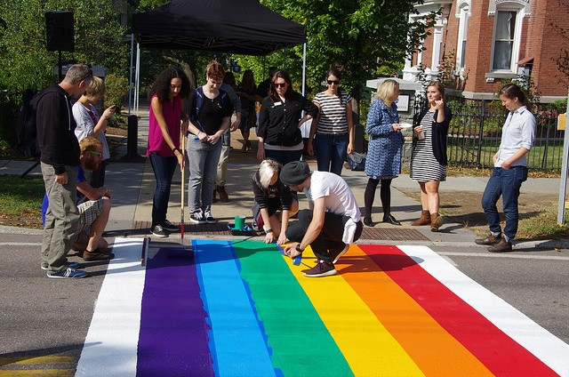 students painting a rainbow crosswalk