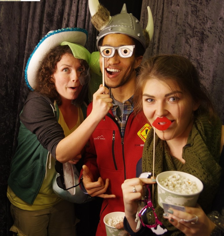 champlain college students making silly faces with props