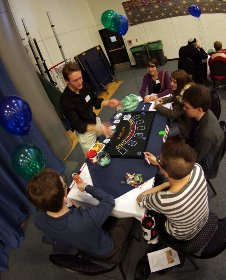 students playing cards at a game table