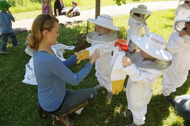 kids wearing beekeeper suits