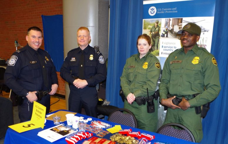 police officers at champlain college career fair