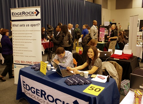 Two recruiters sit at a table at the Champlain College Career Fair