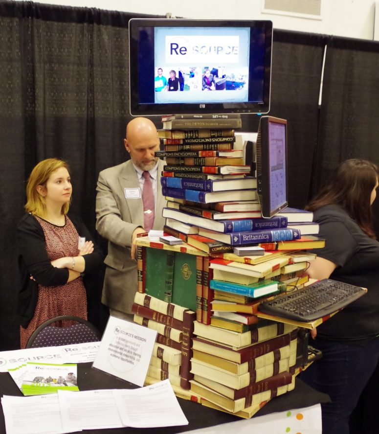 stack of books at champlain college career fair