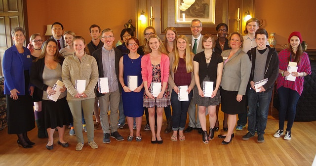 group of students standing with awards