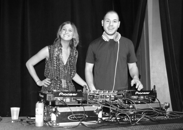 psychology capstone - two students behind a dj booth